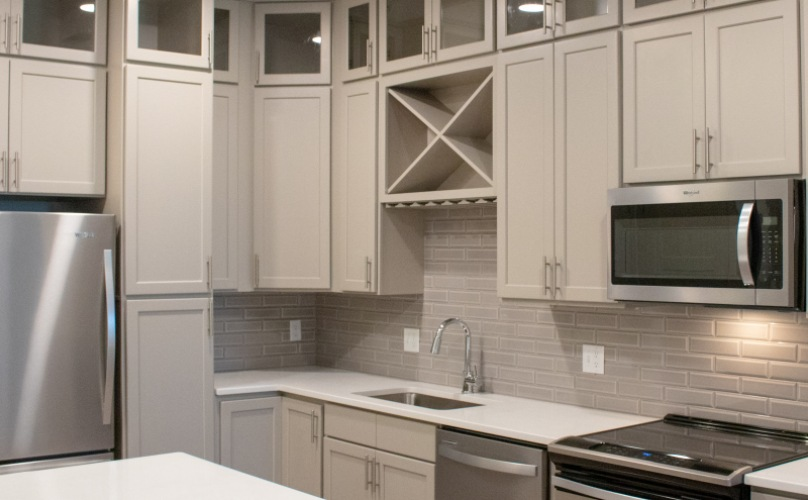 Kitchen with stainless steel appliances and tons of storage at Towerivew at Ballantyne Apartments